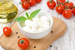 fresh mozzarella in a bowl, cherry tomatoes and olive oil