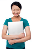 Smiling asian female posing with laptop