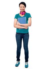 College girl with headphones around her neck