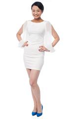 Full length portrait of a girl in party wear dress