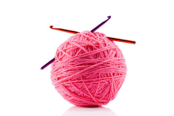 Pink yarn ball and crotchet hooks