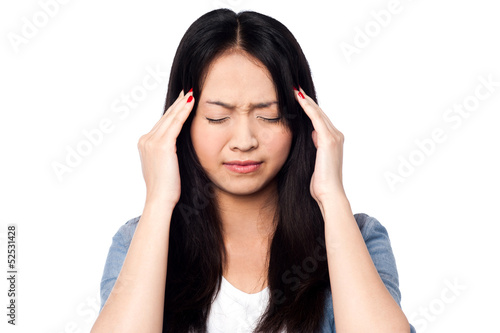 Young girl having headache