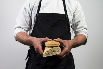 Baker or chef holding bread
