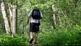 Hiker in the woods on trails /episode1/