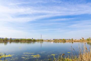 City suburbs and swamps, marsh, lake