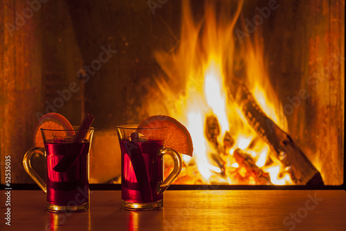 canvas print picture drinks at cozy fireplace