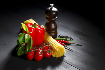Pasta ingredients on black table