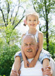 Outdoor portrait of granddaughter and grandfather