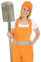 Freundliche junge Bauarbeiterin
