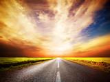 Empty long and straight asphalt road. Sunset Sky