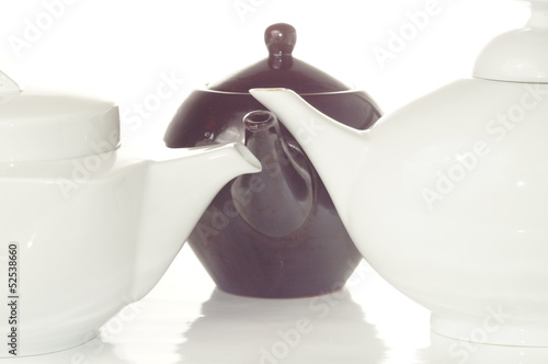 three tea pot isolated on white