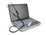 Modern laptop with a stethoscope and syringe for the treatment o