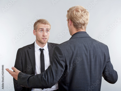 two businessmen standing, discussing