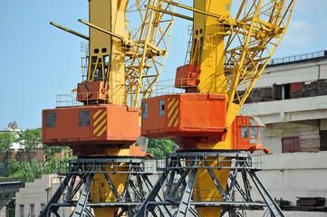 Port cargo crane over blue sky background