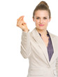 Confident business woman snapping fingers