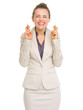Happy business woman with crossed fingers