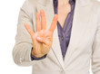 Closeup on business woman showing four with fingers