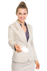 Happy business woman giving business card