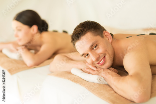 couple in spa with hot stones