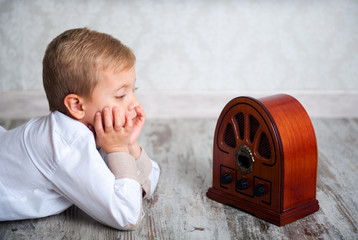 boy listening to retro radio