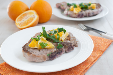 Orange citrus salsa on pork chops