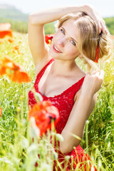 beautiful blonde girl in poppies field