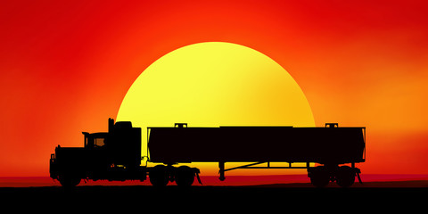 Silhouette of a truck in the background of the setting sun.