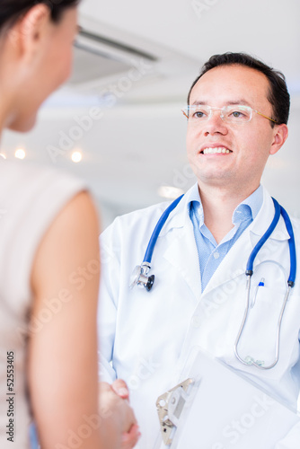 Doctor handshaking with patient