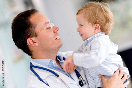 Doctor holding a baby