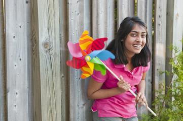 teenage girl with pinwheel