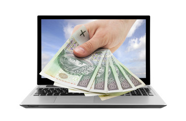 Laptop and hand with polish money. Clipping path included.
