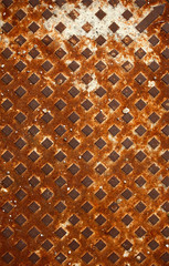 pattern of textured rusty metal with diagonal grid