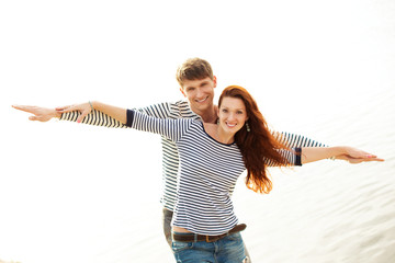 lovely couple smiling on beach