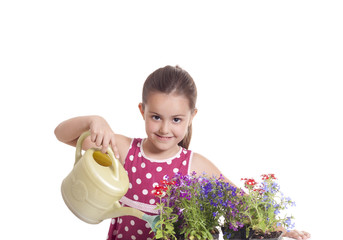little girl with bucket and flowers