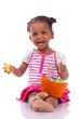 African girl holding chocolate ester egg