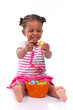 African girl holding chocolate ester egg