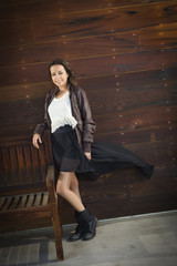 Mixed Race Young Adult Woman Portrait Against Wooden Wall