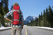 Backpacker on mountain road