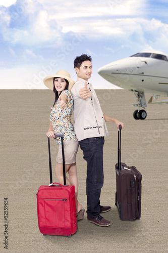 Asian couple travel by airplane