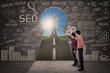 Business partner look for SEO success concept