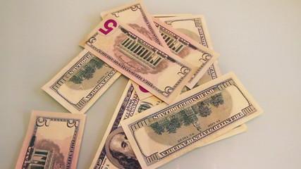 falling dollar banknotes