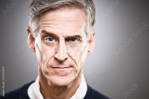 Mature Caucasian Man With Raised Eyebrow Portrait