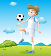 A boy playing soccer during daytime
