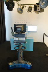 Retro television studio with camera and soffits