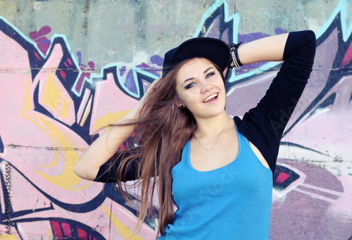 Cheerful Teenager Young Woman against Wall