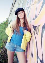 Nice Young Woman Teenager near Urban Wall