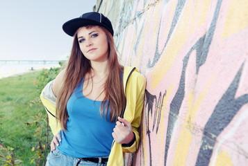 Beautiful Young Woman Teenager near Urban Wall