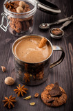Coffee in the old mug, chocolate,   cookies and spices