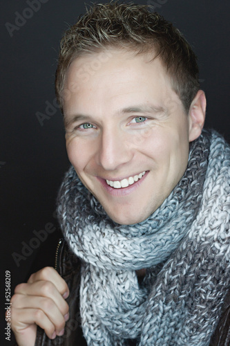 Portrait of a bautiful young man with scarf
