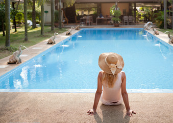 woman in luxury spa resort near the swimming pool